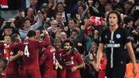 Para pemain Liverpool merayakan gol yang dicetak James Milner ke gawang PSG pada laga Liga Champions di Stadion Anfield, Liverpool, Selasa (18/9/2018). Liverpool menang 3-2 atas PSG. (AP/Paul Ellis)