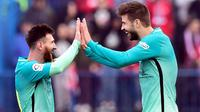 Lionel Messi dan Gerard Pique (AFP/Gerard Julien)