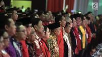 Presiden Joko Widodo atau Jokowi saat menghadiri HUT ke-46 PDIP di JIExpo Kemayoran, Jakarta, Kamis (10/1). Dalam sambutannya Jokowi meminta para kader PDIP untuk menjaga Pancasila. (Liputan6.com/JohanTallo)