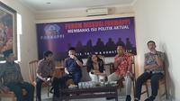 Direktur Eksekutif Sindikasi Pemilu dan Demokrasi (SPD), August Mellaz menyampaikan sebuah formula yang efektif untuk menghitung komposisi kabinet Jokowi-Maruf. (Liputan6/Yopi)