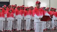 Chief de Mission kontingen Indonesia, Taufik Hidayat saat acara Pengukuhan dan Pelepasan Kontingen untuk SEA Games 2015 Singapura di Senayan, Jakarta, (25/5/2015). (Liputan6.com/Andrian M Tunay)