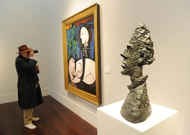 Lukisan Pablo Picasso Nude, Green Leaves and Bust (1932). Photo: Stan Honda/AFP