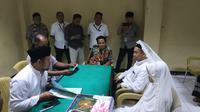 Tersangka pengancam Presiden Joko widodo (Jokowi), Hermawan Susanto (25) menikah di rutan Polda Metro Jaya pada Rabu, 3 Juli 2019. (Merdeka/Ronald)