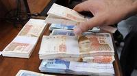 Ilustrasi uang rupee Pakistan (AFP)