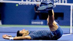 Petenis Serbia, Novak Djokovic berselebrasi usai mengalahkan Juan Martin del Potro (Argentina) pada partai final AS Terbuka  2018 di New York, Minggu (9/9). Mantan petenis nomor satu Novak Djokovic keluar sebagai juara AS Terbuka 2018. (AP/Andres Kudacki)