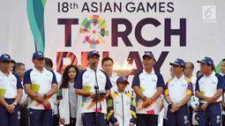 Gubernur DKI Jakarta, Anies Baswedan memberi sambutan usai Api Obor Asian Games 2018 tiba di Balai Kota, Jakarta, Rabu (15/8). (Liputan6.com/Fery Pradolo)