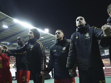 Para pemain Belgia berselebrasi saat merayakan kemenangan setelah pertandingan melawan San Marino pada Grup I Kualifikasi Piala Eropa 2020 di Stade Roi Baudouin, Brussels (10/10/2019). Belgia menang telak 9-0 atas San Marino. (AP Photo/Francisco Seco)