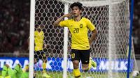 Striker Malaysia, Syafiq Ahmad, merayakan gol yang dicetaknya ke gawang Timnas Indonesia pada laga Kualifikasi Piala Dunia 2022 di SUGBK, Jakarta, Kamis (5/9). Indonesia kalah 2-3 dari Malaysia. (Bola.com/Vitalis Yogi Trisna)