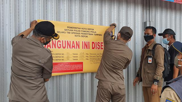 Langgar Perda, Dua Minimarket di Kota Depok Disegel Satpol PP - News  Liputan6.com