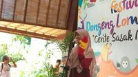 Mendongeng juga dianggap sebagai salah satu cara untuk memulihkan mental anak-anak yang terdampak gempa di Lombok.  (Foto: Liputan6.com/Giovani Dio Prasasti)