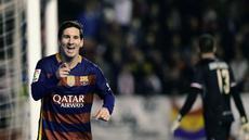 Lionel Messi mencetak hat-trick saat membawa Barcelona menang 5-1 atas Rayo Vallecano pada laga La Liga, di Estadio del Rayo Vallecano, Madrid, Jumat (4/3/2016) dini hari WIB. (AFP/Pierre-Philippe Marcou)