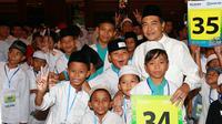 Corporate Secretary Bank BRI, Bambang Tribaroto bersama ribuan anak yatim di acara Ramadan Ceria Bersama Anak Indonesia.