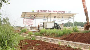 Suasana pembangunan proyek ruas tol Depok-Antasari untuk seksi II yang menghubungkan Jalan Brigif-Sawangan di kawasan Depok, Jawa Barat, Selasa (11/2/2020). Proyek sepanjang 6,3km tersebut ditargetkan beroperasi pada triwulan I-2020. (Liputan6.com/Immanuel Antonius)
