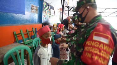 FOTO: Pandemi COVID-19, TNI - Polri Imbau Warga Patuhi Protokol Kesehatan
