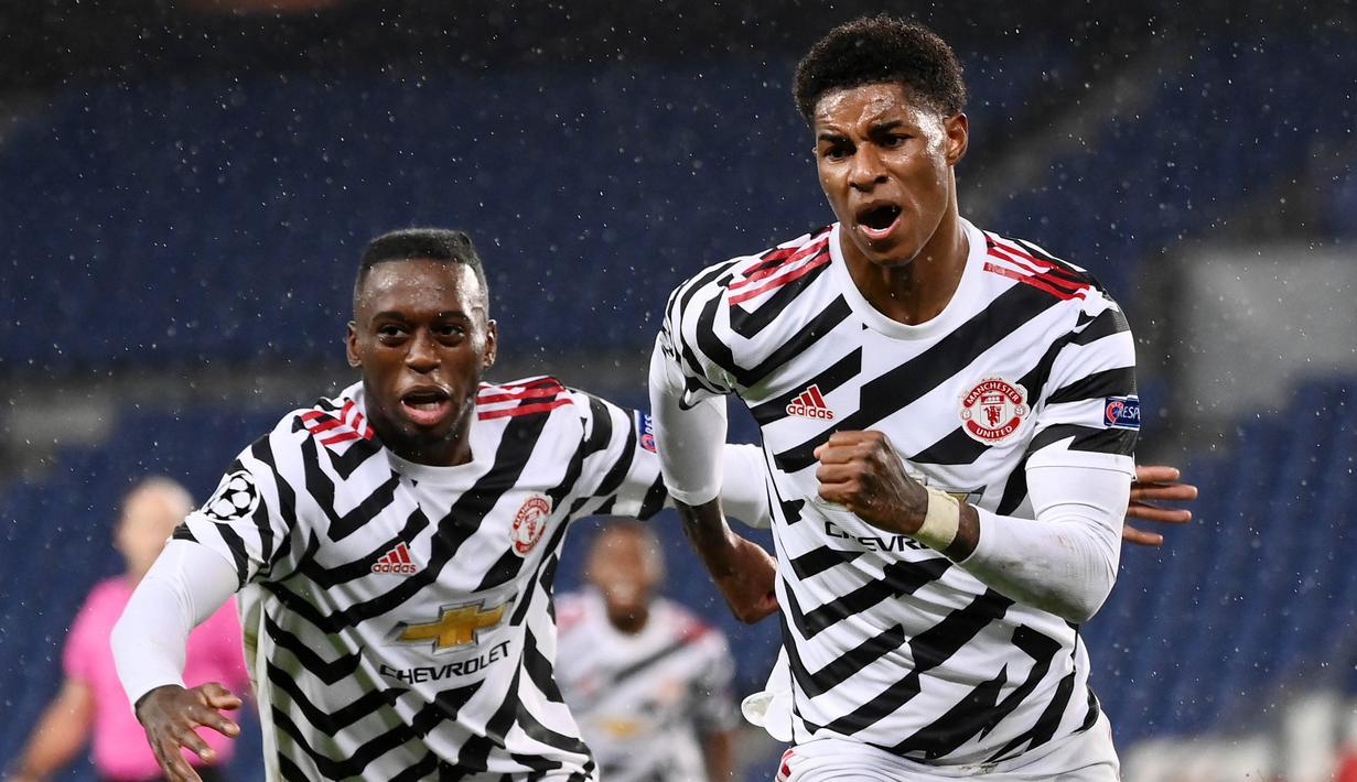 Penyerang Manchester United, Marcus Rashford, melakukan selebrasi usai mencetak gol ke gawang PSG pada laga Liga Champions di Stadion Parc des Princes, Rabu (21/20/2020). MU menang dengan skor 2-1. (AFP/Franck Fife)
