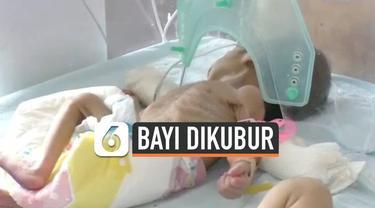 Seorang pria menemukan bayi perempuan yang dikubur hidup-hidup. Penemuan itu terjadi saat ia hendak memakamkan anaknya yang meninggal.