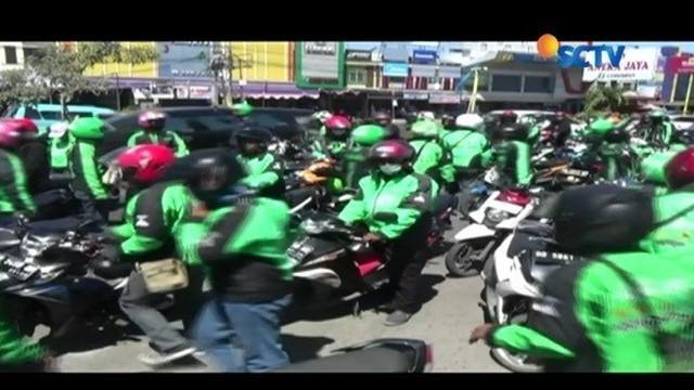 Di Makassar, Sulawesi Selatan, pengemudi ojek online dan ojek pengkolan (konvensional) kembali bersitegang.