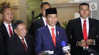 Presiden Joko Widodo atau Jokowi memberi keterangan saat tiba di Istana Merdeka, Jakarta, Minggu (20/10/2019). Usai dilantik menjadi Presiden RI untuk kedua kalinya, Jokowi  langsung kembali ke Istana Merdeka. (Liputan6.com/Angga Yuniar)