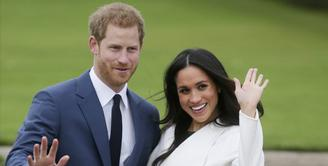 Meghan Markle dikabarkan telah bertunangan dengan Pangeran Harry. Hal tersebut membuatnya menjadi Puteri Inggris pertama dengan yang miliki keturunan kulit hitam. (Daniel LEAL-OLIVAS / AFP)