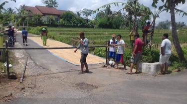 """Desa Purwonegoro, Banjarnegara menerapkan """"lockdown"""" selama 14 hari terhitung sejak 26 Maret 2020. (Dok. Renda Sabita untuk Liputan6.com/Galoeh Widura)"""